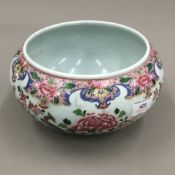 A 19th century famille rose shallow vase