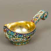 An enamel decorated silver gilt kovsh Of typical form,