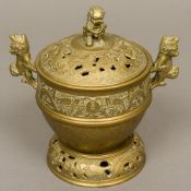 A Chinese bronze censer on stand The pierced removable lid with dog-of-fo finial,