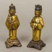 A pair of Chinese Ming gilt bronze models of attendants One male modelled in flowing robes holding