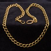 An 18 ct gold watch chain Of curb link design. 55.5 cm long.