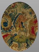 A pair of antique needlework panels Worked with figures, oval framed and glazed. 33 x 43.5 cm.