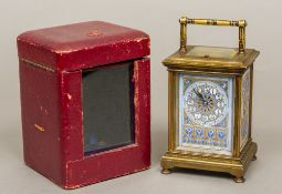 A 19th century porcelain mounted lacquered brass cased repeating carriage clock The porcelain dial