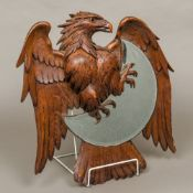 A 19th century Black Forest carved wooden wall glass Modelled as an eagle encompassing the bevelled