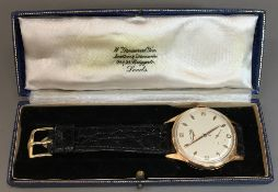 An 18 ct gold cased Longines gentleman's wristwatch The white dial with Arabic numerals,