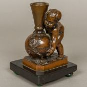 LOUIS-ERNEST BARRIAS (1841-1905) French Putto Lifting a Vase Patinated bronze, the vase signed,