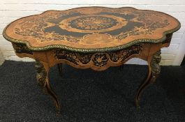A 19th century ormolu mounted marquetry inlaid centre table The cast ormolu banded shaped top