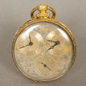 A 19th century 18 ct gold cased double timekeeper pocket watch The multi-dial silvered face