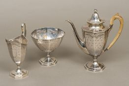 A George III silver three piece tea set, possibly hallmarked for Exeter 1774,