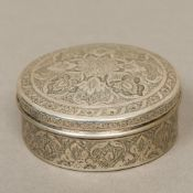 A 19th century Persian silver box With domed removable lid, decorated with scrolling floral motifs.