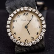 An 18 ct gold cased diamond set lady's cocktail watch The diamond set bezel enclosing the champagne
