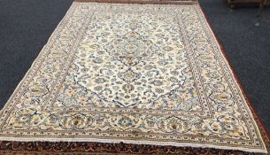 A Kashan wool carpet The ivory field with central medallion with pendant palmettes within arabesque