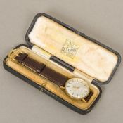A 9 ct gold cased Tissot Seastar gentleman's wristwatch The silvered dial with batons. 3.5 cm wide.