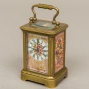 A miniature brass cased carriage clock Set with painted porcelain panels,