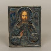 A 19th century Russian icon Painted as a priest with silver overlay,