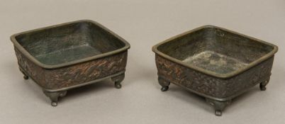 A pair of 19th century Chinese bronze censers Each of square section and worked with dragons
