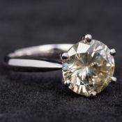 An 18 ct white gold 3 carat diamond solitaire ring The claw set stone above the plain shank. 1.