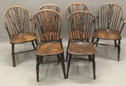 A harlequin set of six 19th century elm seated wheel back chairs,