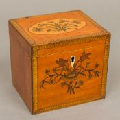 A late George III marquetry inlaid satinwood tea caddy Of rectangular section,