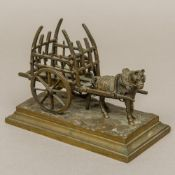 A patinated bronze model of a horse pulling a hay cart Mounted on a naturalistically cast stepped
