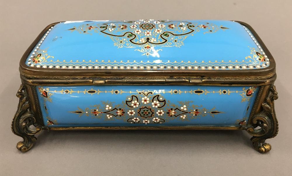 Lot 3 - A 19th century French enamel decorated casket Of domed hinged form,