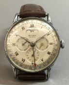A Record Watch Company Datofix triple calendar gent's wristwatch The signed silvered dial with