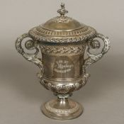 A George IV silver lidded twin handled trophy cup, hallmarked London 1824,