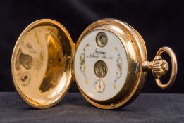 An unmarked 14 ct gold full hunter jump hour pocket watch The decorated white enamelled dial
