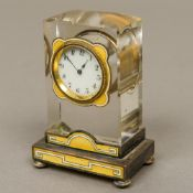 A Continental silver and enamel decorated crystal desk clock The white enamelled dial with Arabic