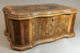 A 19th century Italian olive wood, walnut and specimen wood inlaid box Of serpentine form,