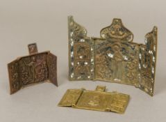 A 19th century Continental enamel decorated brass religious triptych Of typical folding form;