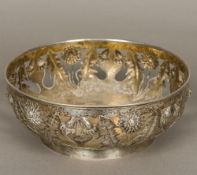 An early 20th century Danish Arts & Crafts pierced silver bowl Repousse decorated in the round with