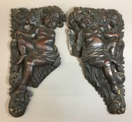 A pair of 17th/18thcentury Continental carved putto reliefs Each scantily clad winged figure before