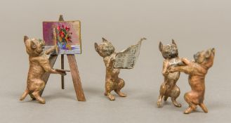 An Austrian cold painted bronze model of a pug type dog Reading a newspaper;