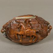 A 19th century coquilla nut snuff box The hinged oval lid carved with Napoleon on horseback before