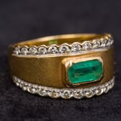 A high carat gold, diamond and emerald ring Of band form,