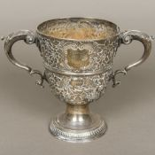 A Georgian Irish silver twin handled trophy cup, hallmarked Dublin, maker's mark of R.