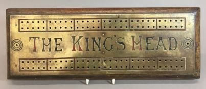 A Victorian brass mounted Taverns cribbage board inscribed The King's Head 41.5 cm wide.