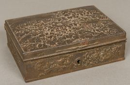 A Japanese Meiji period cast iron box Of hinged rectangular form,