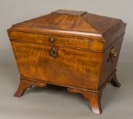 An early 19th century mahogany cellaret Of small proportions,