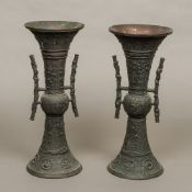 A pair of Chinese archaistic style patinated bronze vases Each of flared cylindrical form with twin
