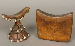 An African tribal carved wooden headrest Of typical curved form, with carved spreading central foot,