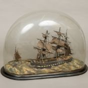 A model sailing ship diorama The main three masted vessel beside a single masted vessel and a