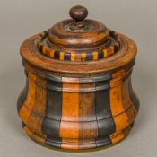 A 19th century Dutch specimen wood tobacco box Of waisted turned lidded form,