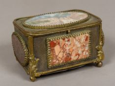A late 19th century Continental gilt metal casket The hinged cover inset with an architectural