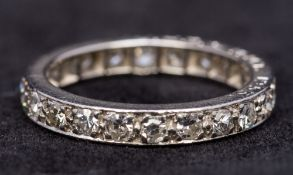 A diamond set platinum eternity ring Of typical form.