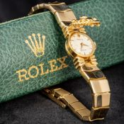 An 18 ct gold lady's Rolex cocktail watch The encased dial inscribed Rolex Precision,