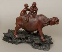 A 19th century Chinese well carved group of boys riding a water buffalo Typically worked and