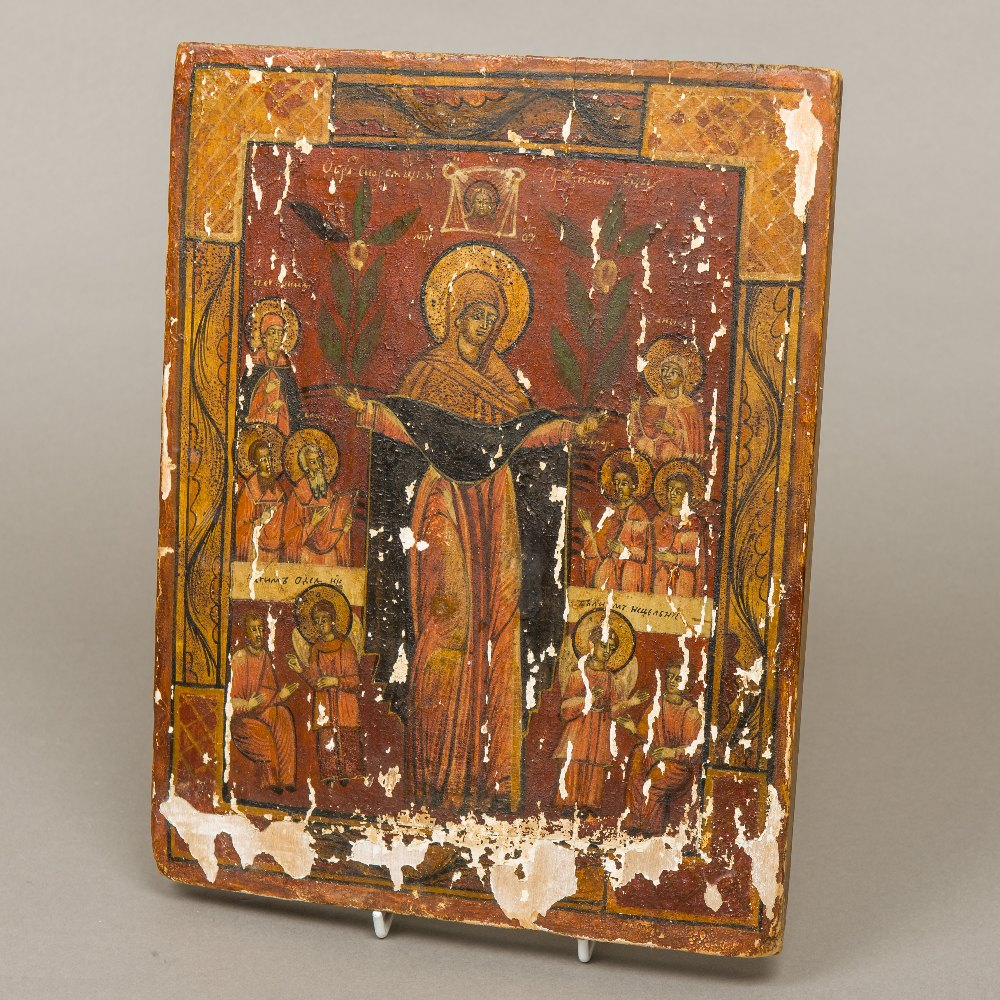 Lot 33 - A Russian icon Painted with various saintly figures on wooden board,