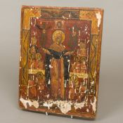 A Russian icon Painted with various saintly figures on wooden board,